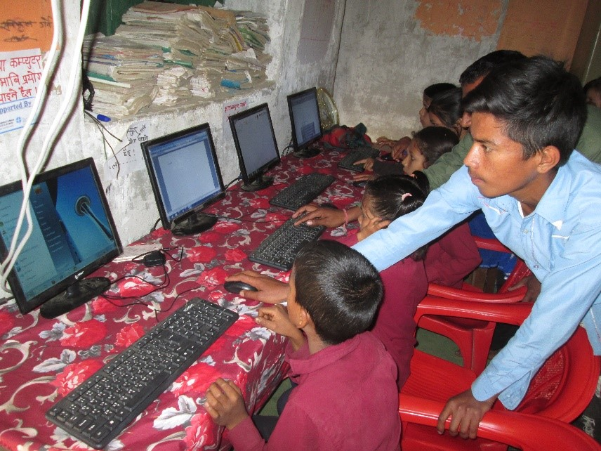 school children learning from computer course